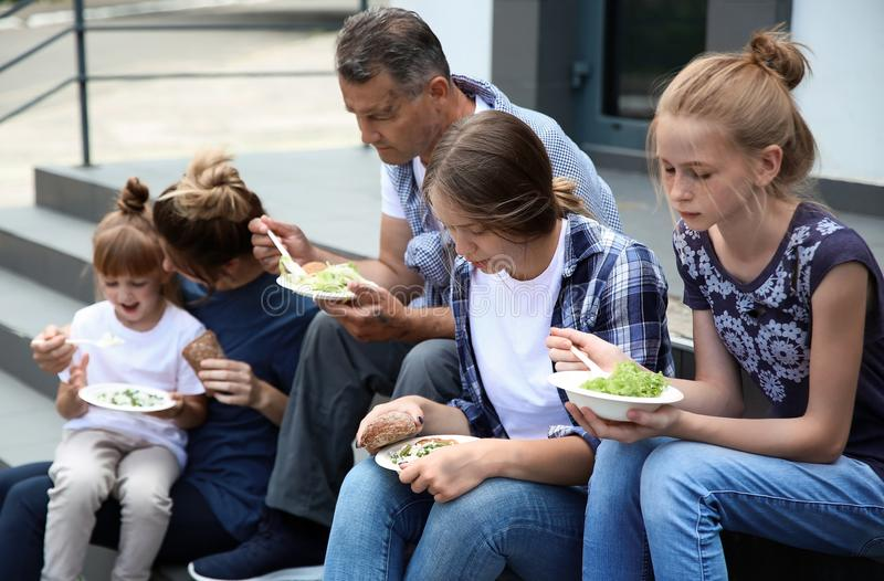 Poor people eating donated food royalty free stock photography
