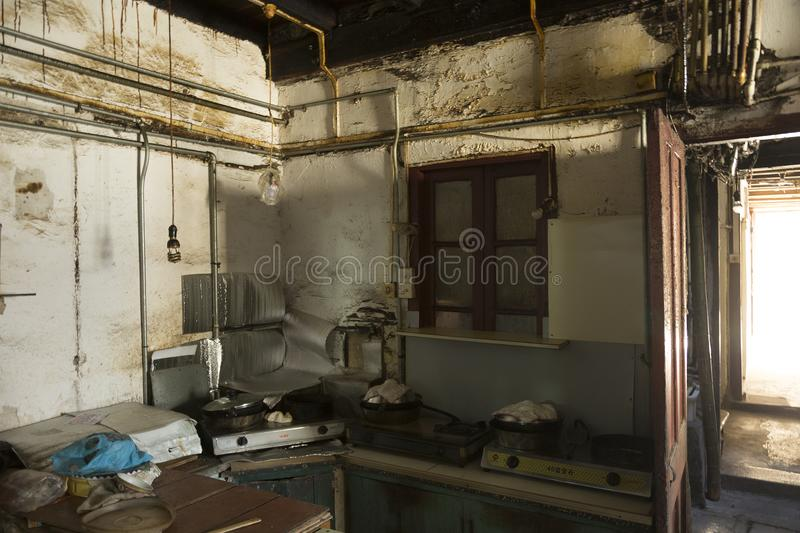 Poor people kitchen in Shanghai, China. Old parts of Shanghai can where lot of poor people live can be found not far away from the famous new city landmarks royalty free stock photos