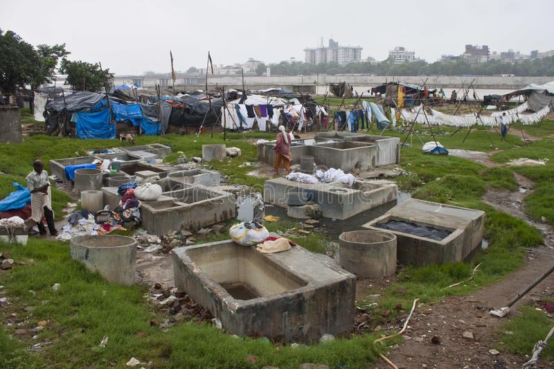 Poor people living in slum stock photos
