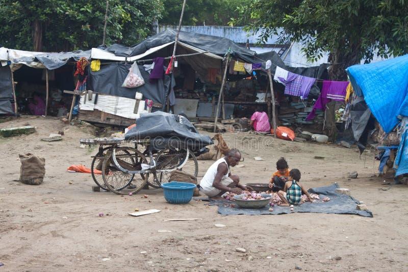 Poor people living in slum. AHMEDABAD, INDIA - SEPTEMBER 7: Unidentified poor people living in slum at September 7, 2011 in Ahmedabad, India. About 40 % of royalty free stock photo