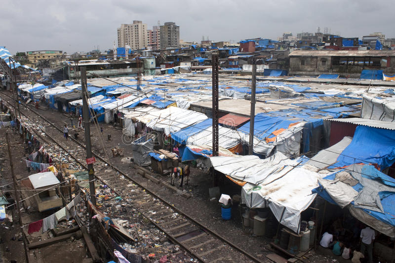Poor people living in slum. MUMBAI - AUGUST 21: Unidentified poor people living in slum at August 21, 2011 in Mumbai, India. About 40 % of Ahmedabad inhabitants royalty free stock image