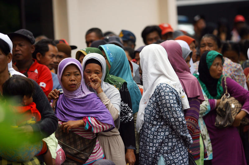 Poor people. Queuing to receive alms from the government offices in the city of Solo, Central Java, Indonesia stock photography