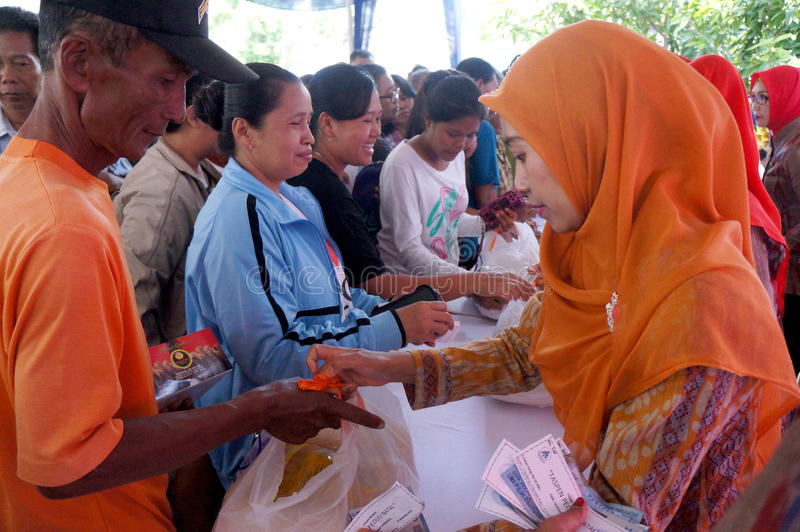Poor people. Receive food aid from the government in the city of Solo, Central Java, Indonesia royalty free stock images
