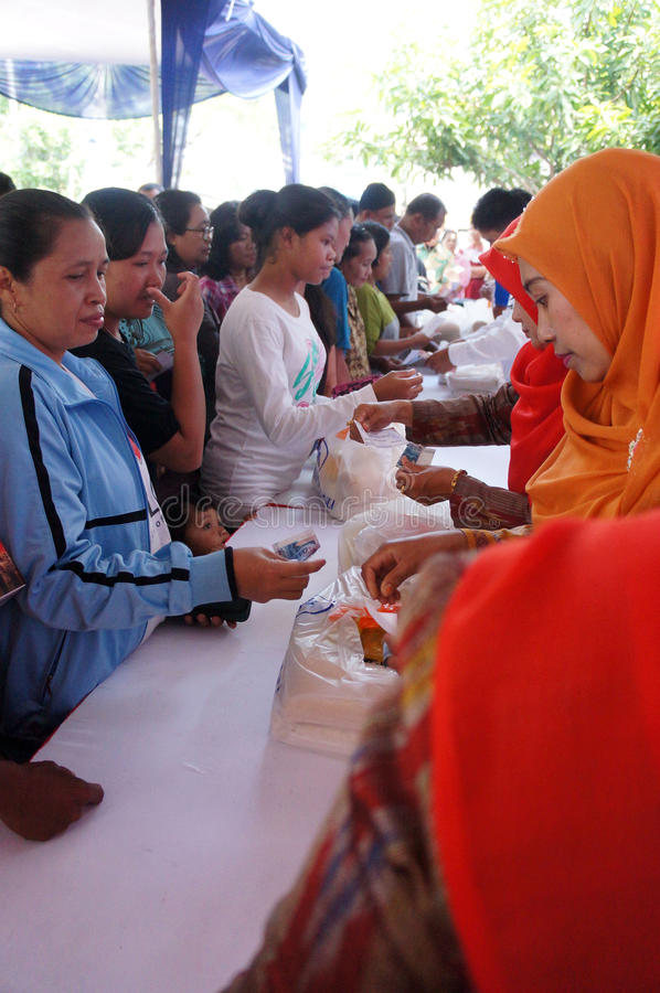 Poor people. Receive food aid from the government in the city of Solo, Central Java, Indonesia royalty free stock photos