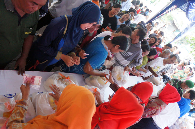 Poor people. Receive food aid from the government in the city of Solo, Central Java, Indonesia royalty free stock photo