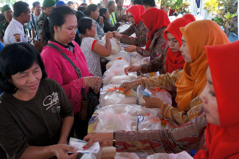 Poor people. Receive food aid from the government in the city of Solo, Central Java, Indonesia stock image