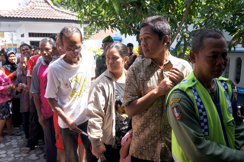 Poor people. Receive food aid from the government in the city of Solo, Central Java, Indonesia stock images
