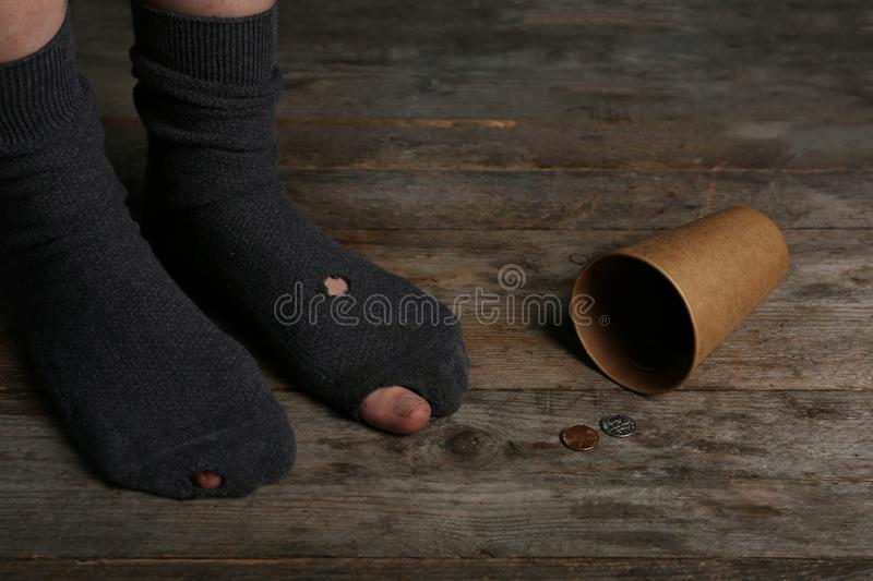 Poor person in shabby socks begging for money,. Closeup royalty free stock images
