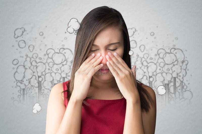 Poor quality of life in the city. A woman in a red dress catches her nose because of a bad smell, Against toxic smoke cartoon background, Poor quality of life in stock photos