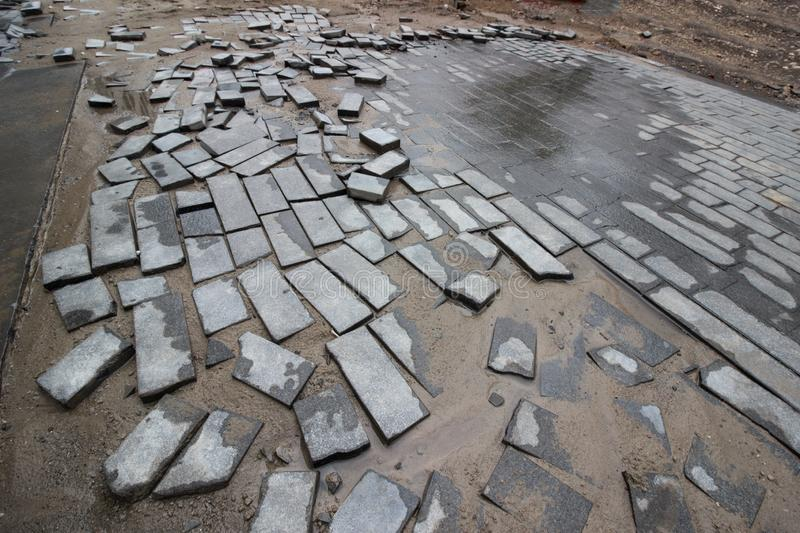 Poor quality paving stones, road blurred, road repair close up. Poor quality paving stones, road blurred, road repair close up royalty free stock photo