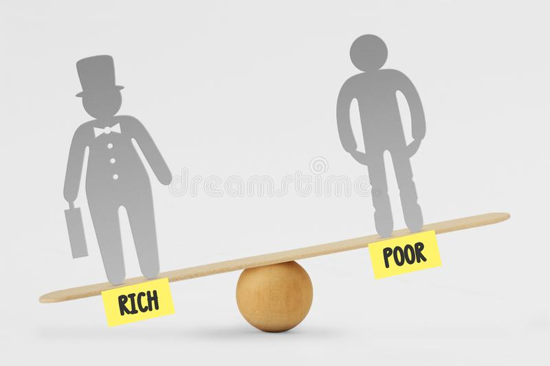 Poor and rich people on balance scale - Concept of social inequality between rich and poor people royalty free stock photos