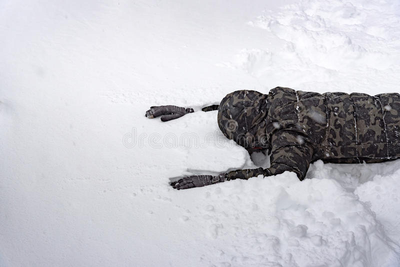 Poor senseless traveller. Close up of poor senseless traveler lost his way in the snow forest on the mountain royalty free stock photography
