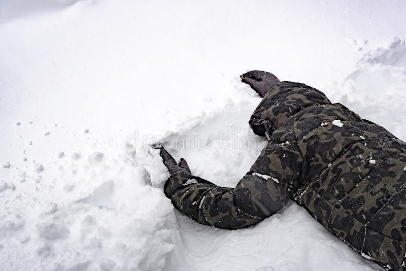 Poor senseless traveller. Close up of poor senseless traveler lost his way in the snow forest on the mountain royalty free stock image