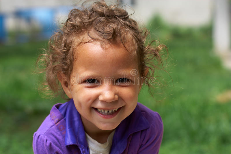 Poor but still happy cute little gypsy girl stock images