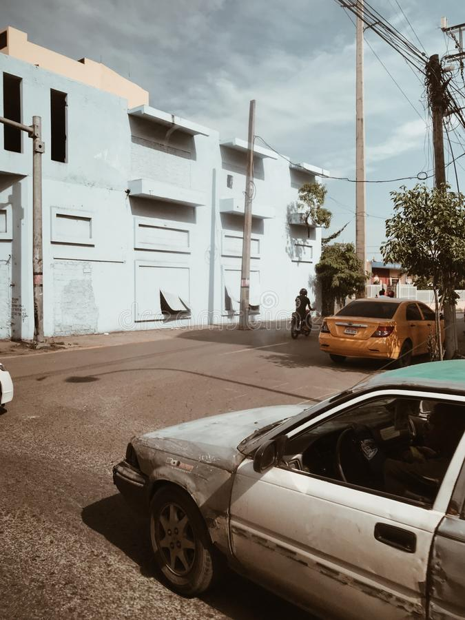 Poor streets of santo domingo, autumn 2018. Poverty on the streets of Santo Domingo. Broken cars, poor people, criminal districts, broken houses, mud and rubbish stock photography