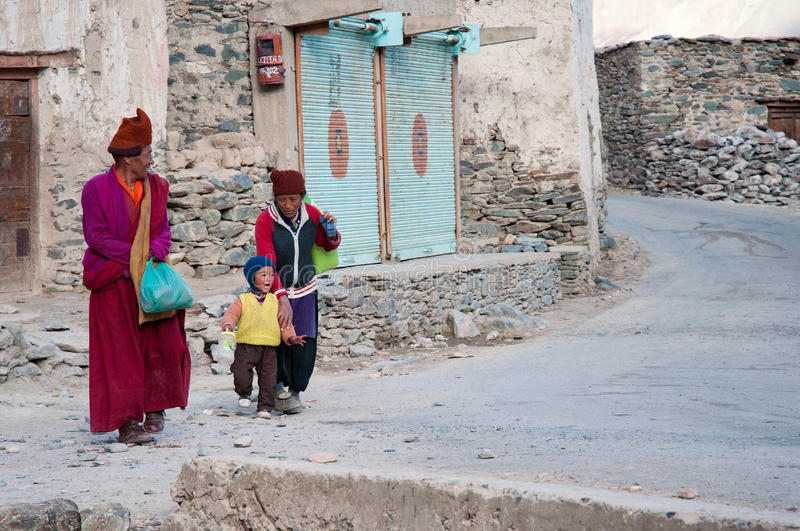 Poor tibetan refuegee family on street in indian city of Leh royalty free stock photography