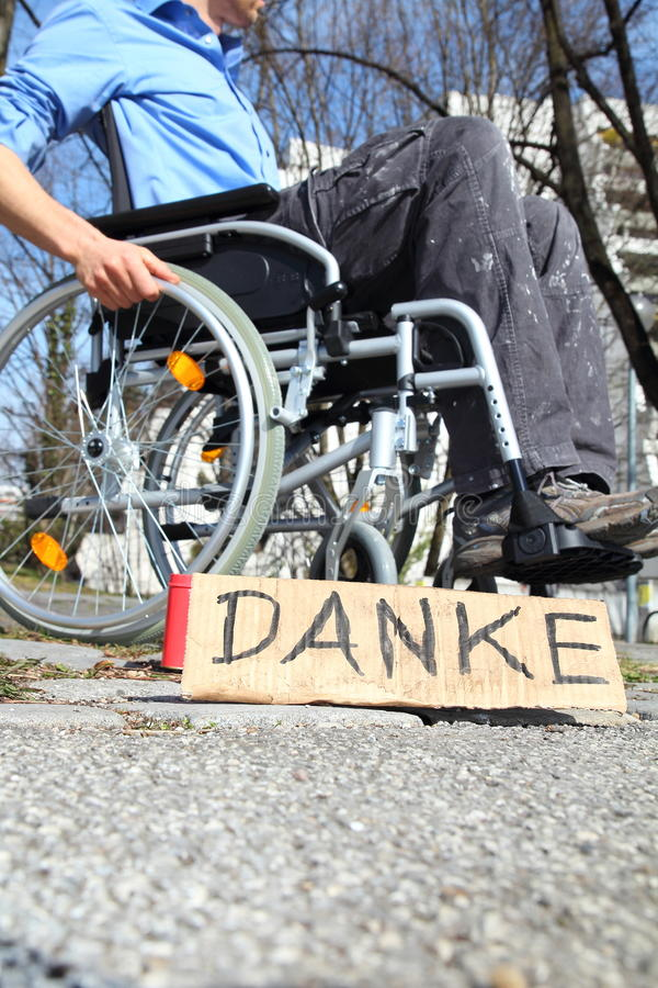 Poor wheelchair user. In a city waiting for money royalty free stock photography
