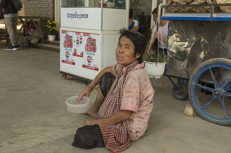 Poor woman in Cambodia stock photography