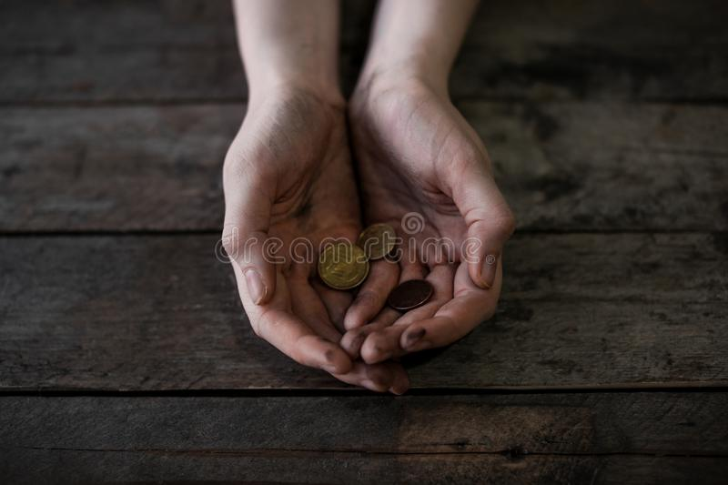 Poor woman with coins royalty free stock image
