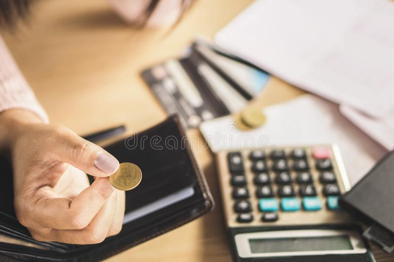 Poor woman hand holding coin after payday, bankruptcy broke stock photos