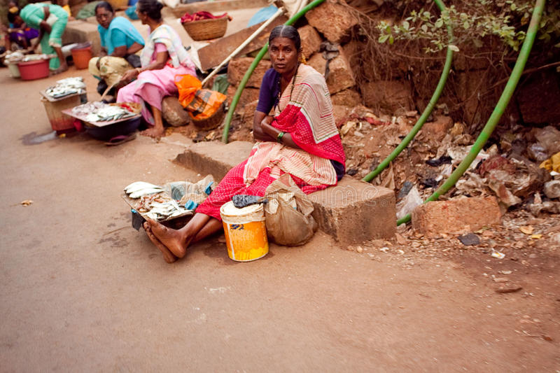 Poor woman near road stock photography