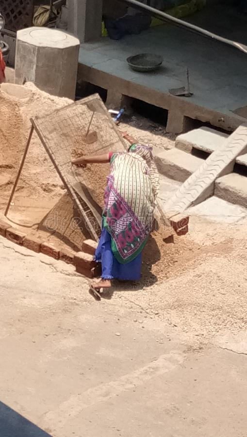 Poor   women labour building material in India MP stock images