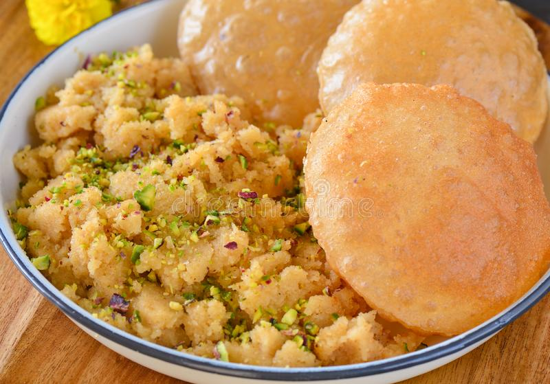 Poori halwa. Indian breakfast on festival. Fried poori served with semolina halwa royalty free stock image