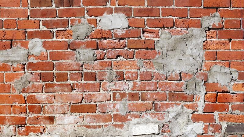 Poorly repaired and patched up brick wall stock image