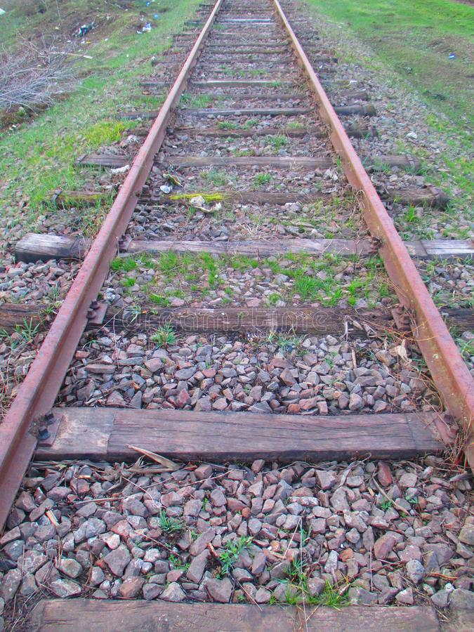 Railroad in spring. Poorly used and forgotten lines in the spring that the end will not appear on the weed vegetation around stock photography