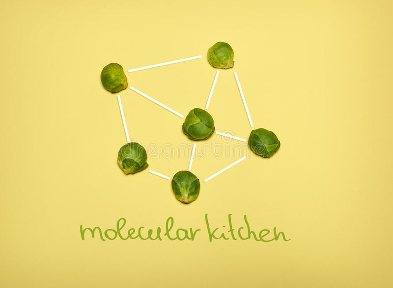 The pop art collage of Chemical molecule structure and fresh Brussels sprouts on yellow stock image