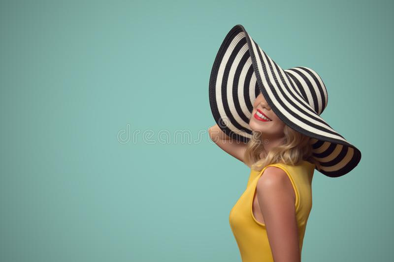 Pop art portrait of beautiful woman in hat. royalty free stock photography