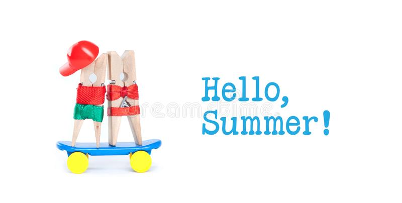 Pop art style Hello summer concept. Clothespin skateboarders. Skating boy, girl on blue skate board. White background. royalty free stock image