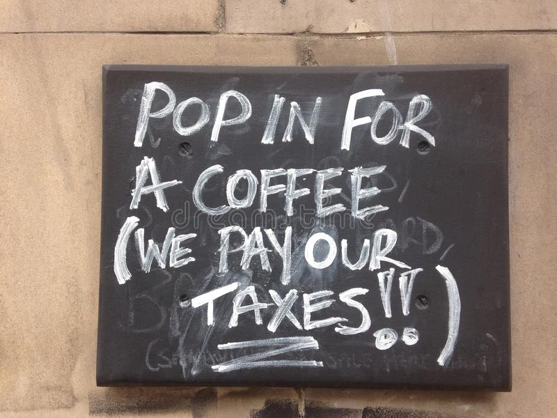 Pop in for coffee. Tabloid outside a coffee shop - they pay stock photography