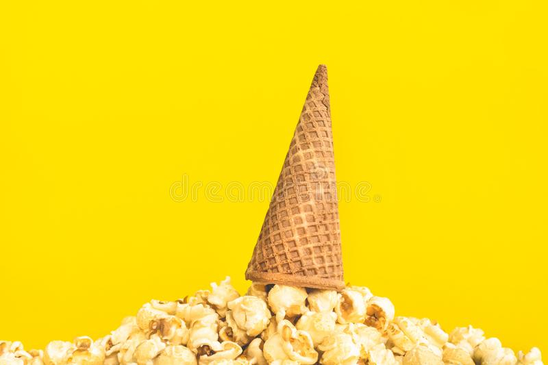 Pop corn with ice cream cone on pastel color background. Food and snack concepts ideas.Minimal style stock photos