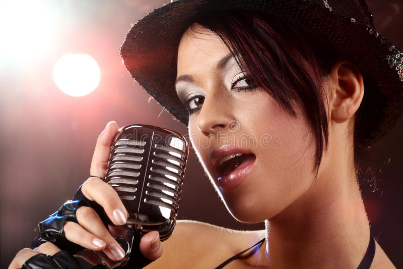 Pop female singer. With the retro microphone stock image