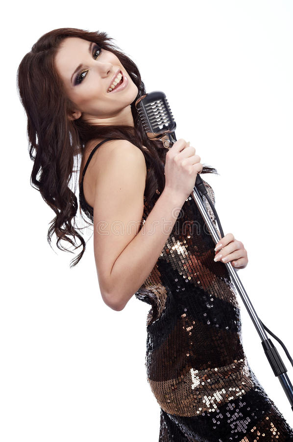 Pop female singer. With the retro microphone royalty free stock images