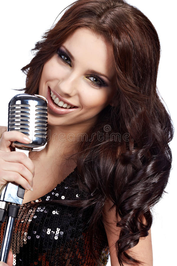 Pop female singer. With the retro microphone royalty free stock image