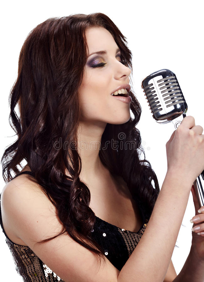 Pop female singer with the retro mic. Rophone stock photo