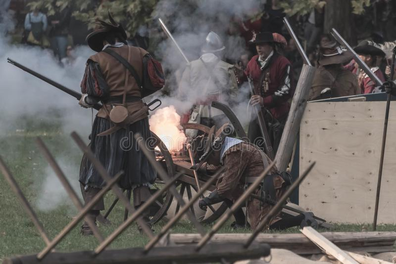 Pop off moment of a historical cannon. Popping off a historical cannon during battle reconstruction in a park stock photos
