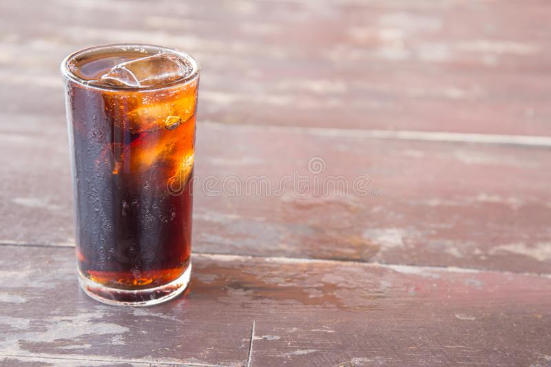 Pop water or cola in glass with ice cubes. Pop water or cola in glass with ice cubes for the background stock images