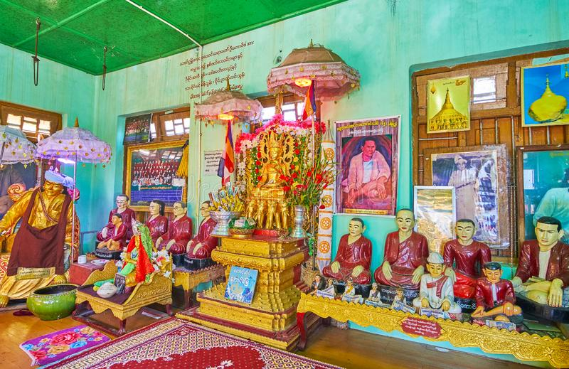 The Nat Shrine of Popa Taung Kalat monastery, Myanmar. POPA, MYANMAR - FEBRUARY 26, 2018:  Interior of Nat shrine of Taung Kalat Temple with altar and Buddhist royalty free stock photography