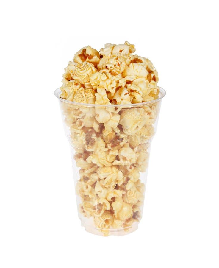 Popcorn στο πλαστικό γυαλί στοκ φωτογραφίες