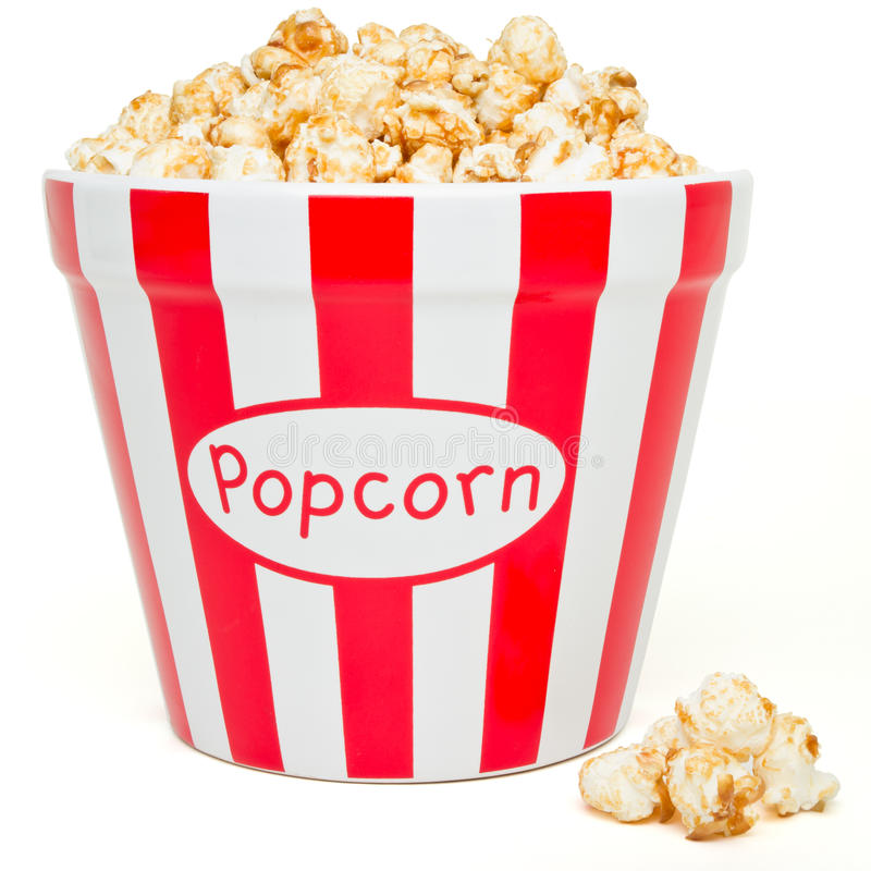 Popcorn. Red and white bowl of popcorn from low perspective isolated on white stock photography