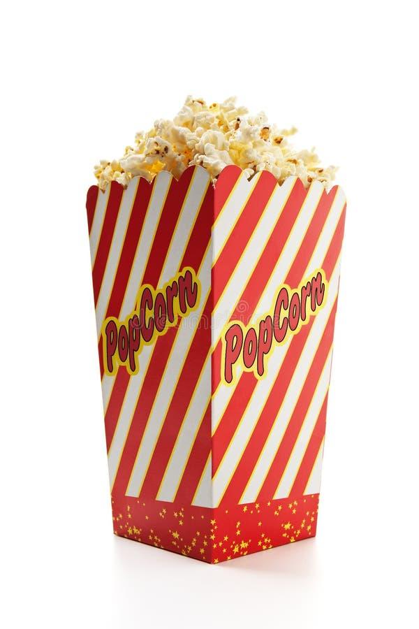 Popcorn. A tall classic box of theater popcorn stock photos
