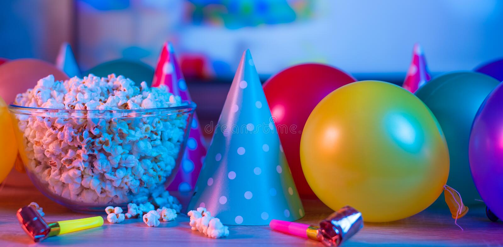 Popcorn birthday, party. On the background of TV and color bright light. Concept of festivals. Food celebration event delicious colorful tasty decoration royalty free stock photos