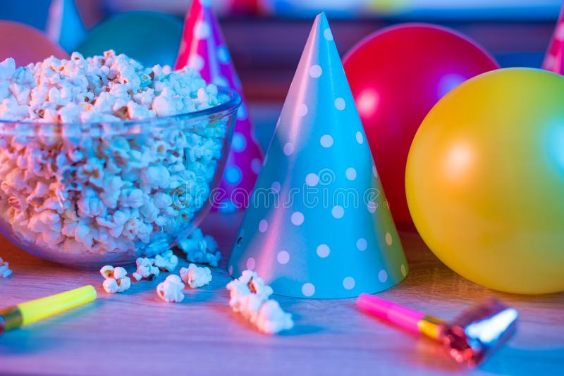 Popcorn birthday, party. On the background of TV and color bright light. Concept of festivals. Food celebration event delicious colorful tasty decoration stock photo