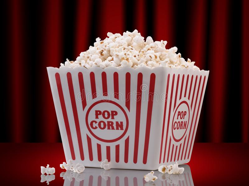Popcorn box. On red curtain background royalty free stock photos