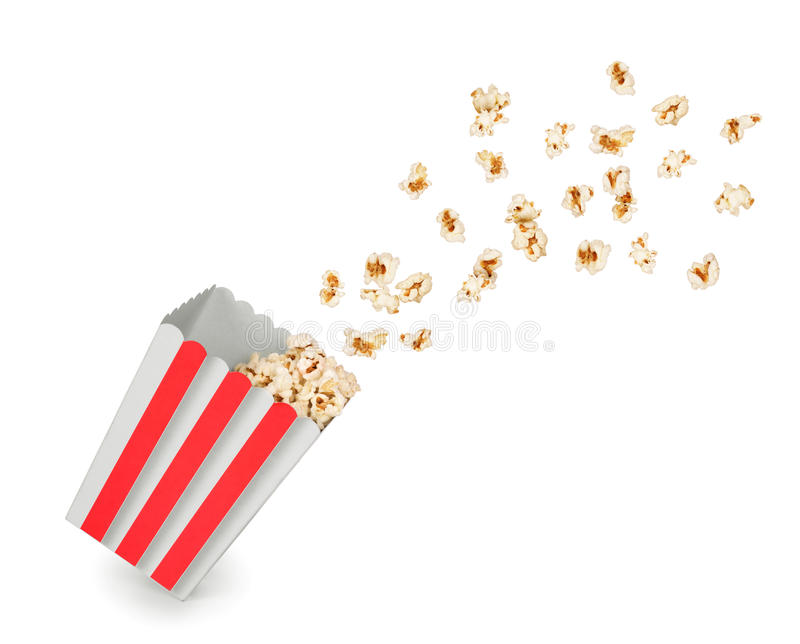 Popcorn with flying kernels from red. White cardboard box royalty free stock image