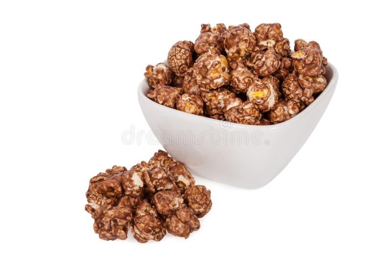 Popcorn gewürzt mit süßer Schokolade und der Minze lokalisiert auf Weiß stockbilder