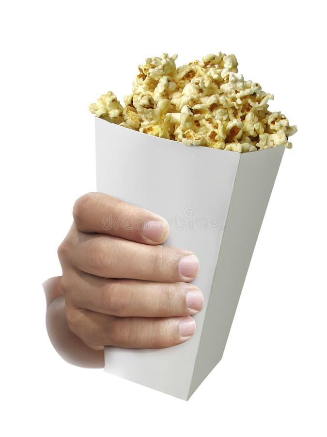 Popcorn an Hand lokalisiert auf einem weißen Hintergrund stockbild